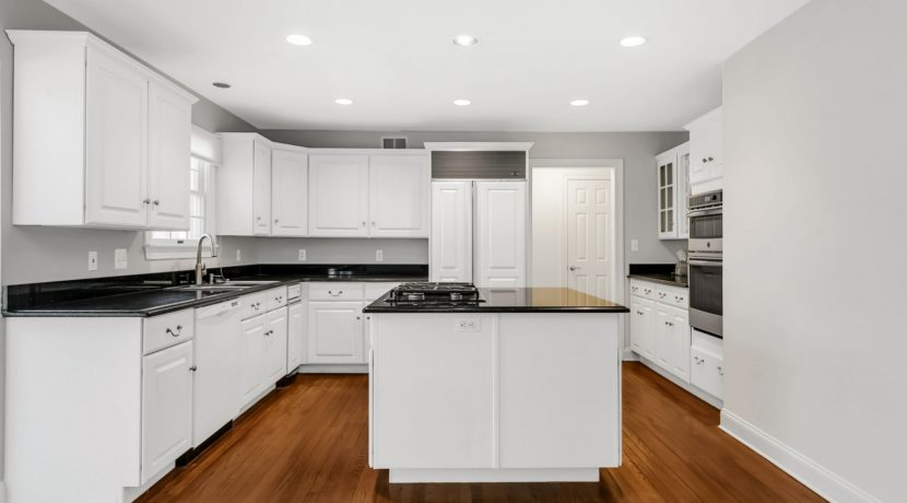 7. Crisp White Cabinetry & Granite Counters