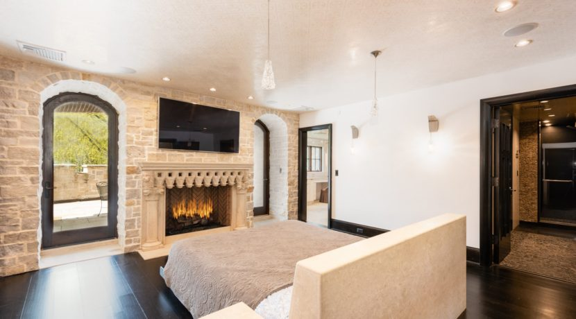 24. Luxurious Master Suite with Fireplace