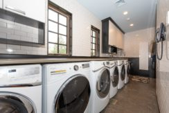 39. Remarkable Laudry with a Set of 3 Washers & Dryers